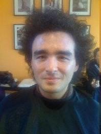 guy's straightening hair before