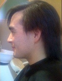 guy's straightening hair after